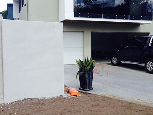 rendered-wall-driveway